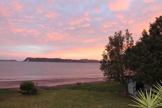 On the Beach B & B: The reflected sunset over Mercury Bay