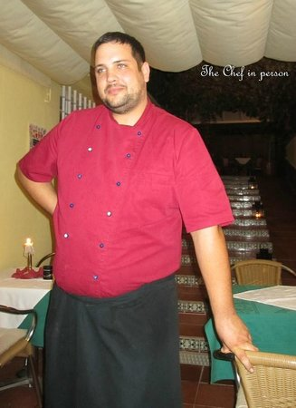 The New Rustico Maspalomas : In charge of the pots and pans..... knows his business!