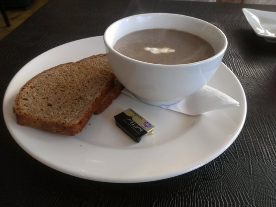 Infinity Restaurant: Homemade Mushroom Soup with Rye bread made on the premises