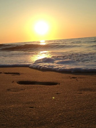 Carousel Resort Hotel & Condominiums: Sunrise Foot Prints in the Sand...!