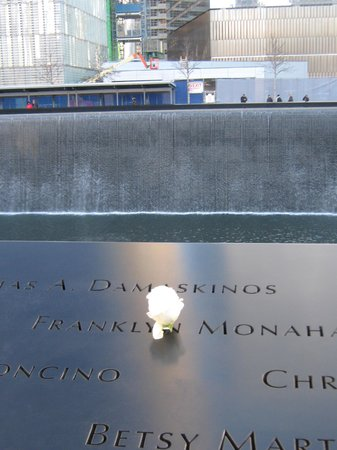 National September 11 Memorial und Museum: The Memorial staff places a rose on victims' birthdays