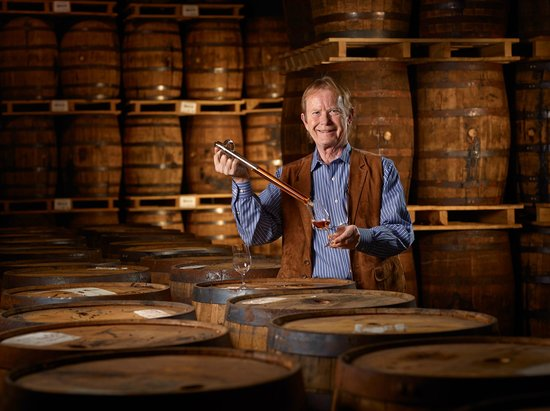 Forty Creek Distillery : John Hall, Whisky Maker sampling with a barrel thief