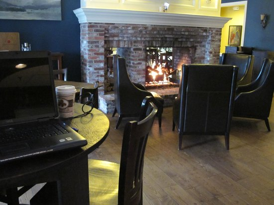 The Daniel: Large fireplace between the dining room and the bar