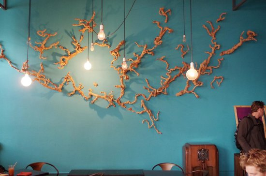 Nice wall art - each light bulb is different - Picture of Cafe Divis ...