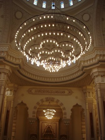 Chandeliers and stucco walls at the interior of Al Noor Mosque