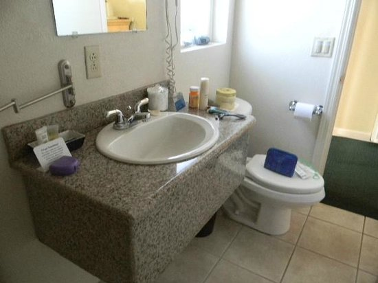 The Wilkie's Inn - Clarion Collection: granite sinktop with toilet blocking door