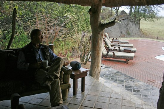 Tangala Safari Camp: Open living area overlooking pool and waterhole further out