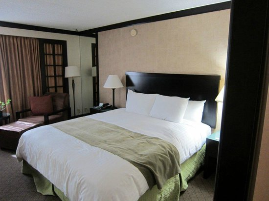 Miyako Hotel Los Angeles : Comfortable bed and reading chair with footrest