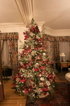 A Christmas Tree Decorated With Vintage Postcards In The