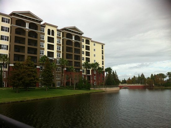 Hilton Grand Vacations at Tuscany Village: Buildings looking from the lake bridge.