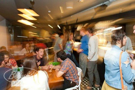 Belushi's: Grab a round at the bar.