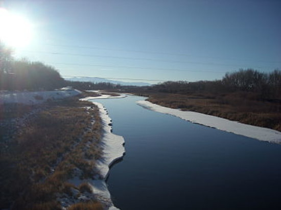 The mighty Rio Grande River carves its way through Alamosa as it begins to freeze.