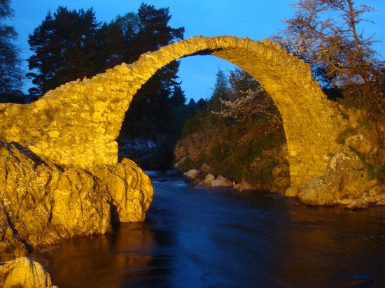 Rosegrove Guest House: Historic packhorse bridge at night at Carrbridge