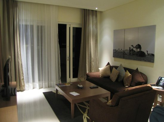 Jannah Eastern Mangroves Suites: The living room of the suite with access to the terrace