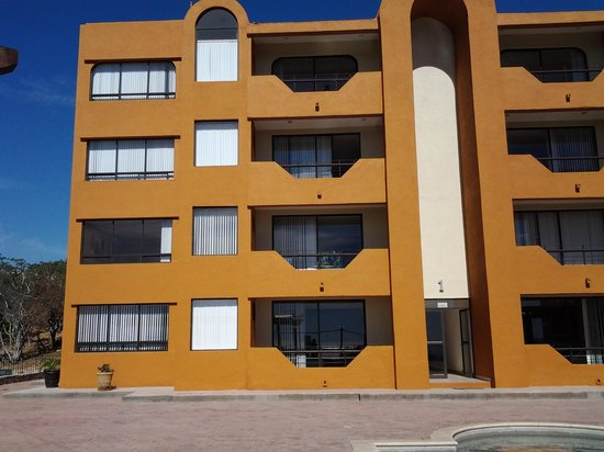 Sunrock Condo Hotel : Front of all units - ours was the 2nd floor unit on the left with the curtains drawn - perfect!