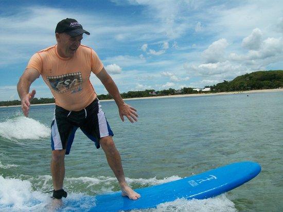 Fiji Surf School: My husband cathing a wave
