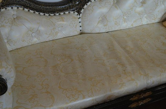 White Pearl Suites : Room Couch with Ink Stains