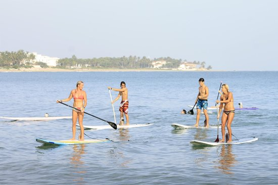 Blossom - Day Lessons : Paddling out after a session of Yoga Sup