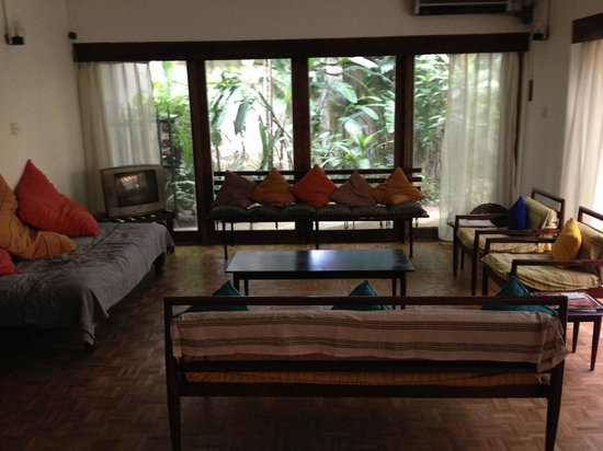 Ranjit's Ambalama: The guest side lounge. Useful ceiling fans in the heat, shady garden to right.