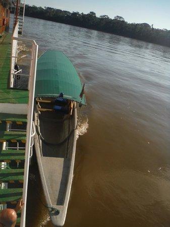 Manatee Amazon Explorer: Canoe aside the boat.