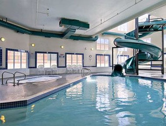 Indoor pool with waterslide  Indoor Pool, Hot Tub And Water Slide - Picture of Ramada Cochrane ...
