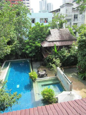 Ariyasomvilla: View of the hotel pool and spa building from the room