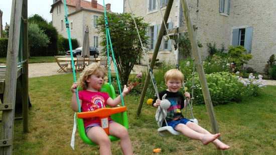 Manoir du Moulin : Having fun on the swings with Warren & Shari's little boy