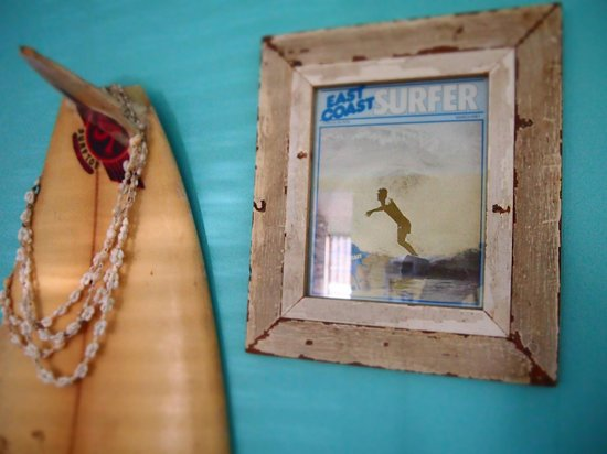 Umzumbe Surf House & Surf Camp: Vintage surfboards and magazines show off the historic story of the 100 year old beach house.