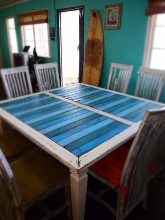 Umzumbe Surf House & Surf Camp: The indoor dining table is perfect for meals and card games.