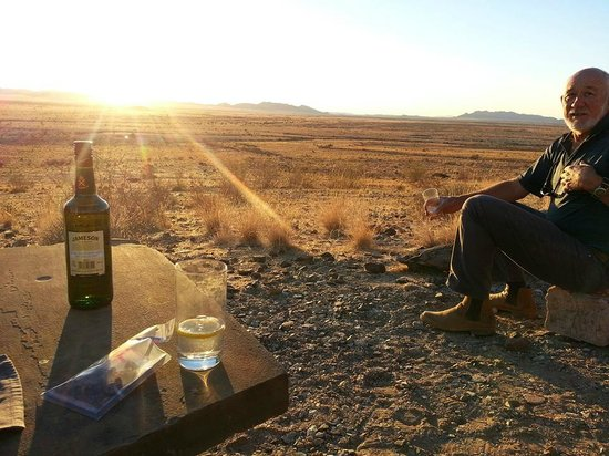 Barchan Dune Retreat: Enjoying a drink watching sunset after a game drive with Williams