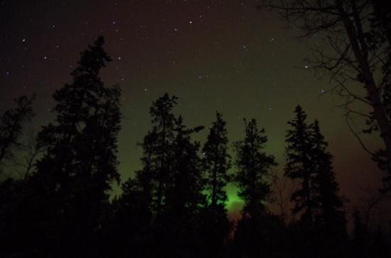 Sundog Retreat: Northern Lights shot from bedroom door/poorch of Fuzzy Crocus Cabin