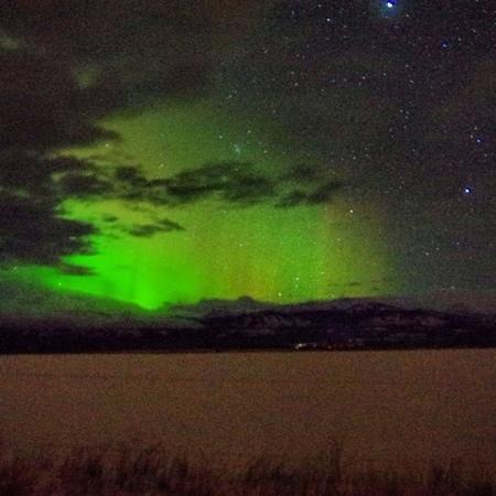 Aurora thru clouds at Sundog Retreat