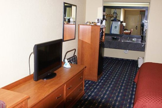 Quality Inn: The TV, refrigerator, microwave, and sinks
