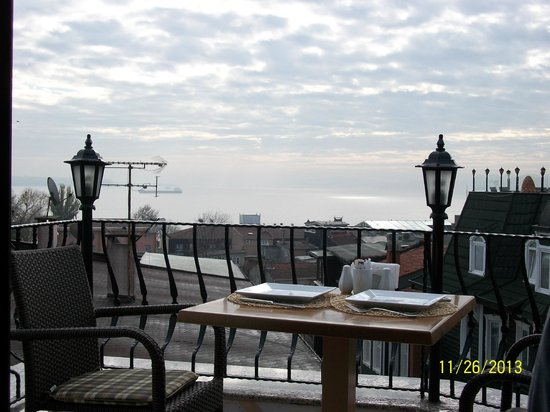 Osmanhan Hotel : View from the terrace- note lovely outiside table setting, balcony rails. Bosphorus view on one