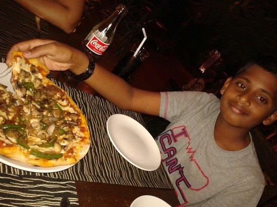 "Jamies Restaurant: My son enjoying the Italian veg pizza. ""Yummiest""!"