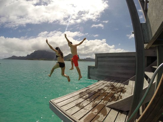 Four Seasons Resort Bora Bora: Jumping from deck of Bungalow 431 (farthest out on the pontoon, the water is pretty deep)