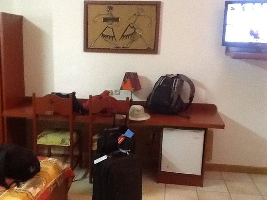 Hotel Independence : Large countertop/desk & frig...sorry about our luggage in photo....