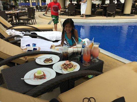Marival Residences Luxury Resort Nuevo Vallarta: My lil Neice enjoying some poolside food!