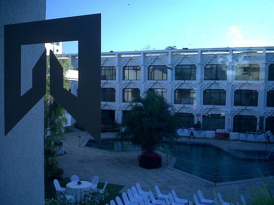 Welcomhotel Vadodara: Welcom logo and pool side ready for banquet with hotel rooms