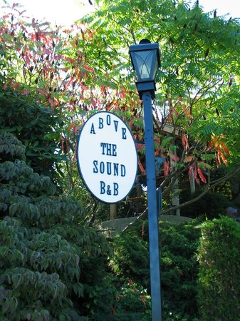Above The Sound Bed and Breakfast : Sign @ Corner of Lot.  Small taste of beautiful gardens