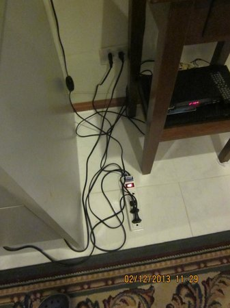 Cordia Residence Saladaeng: Extension cords & wiring hang loose in the kitchen area