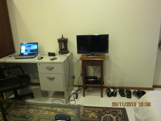 An Office Type Table And 14 Inch Tv In The Deluxe Room Picture Of Cordia Residence Saladaeng Bangkok Tripadvisor