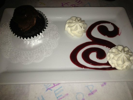 S & P Oyster Co: Cupcake with Raspberry Drip and Whip Cream