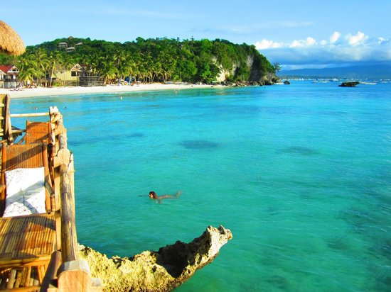 Spider House Resort: White Beach begins right after these rocks