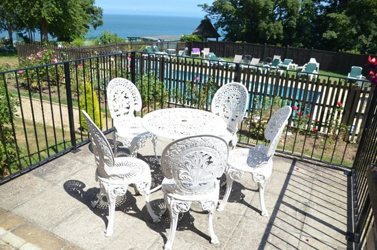 Balcony - Enjoy Afternoon Tea Outdoors with Sunning Pool & SeaViews at Luccombe Manor Country House Hotel