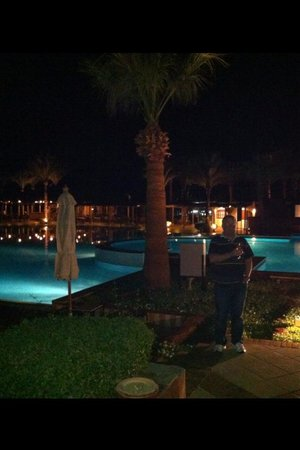 Jaz Fanara Resort & Residence: Pool area at night
