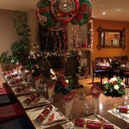 Le Gouffre Cafe and Restaurant: The prepared table in front of a log fire