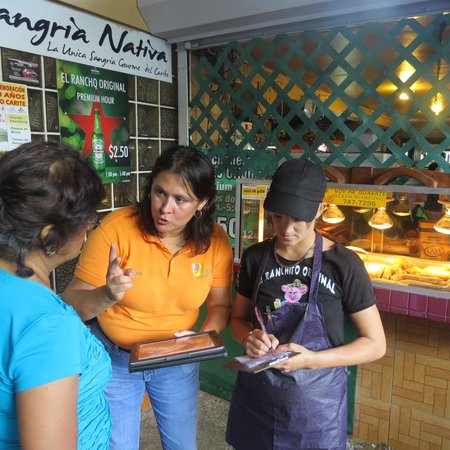 Legends of Puerto Rico: Debbie our Tour Guide assisting a customer to order lunch with the Hostess.