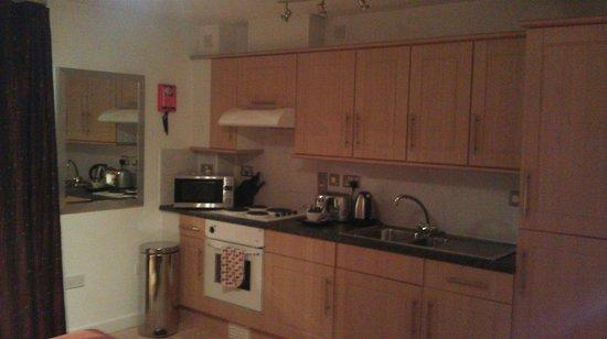 PREMIER SUITES Birmingham: Kitchen Area with Utensils, Microwave etc