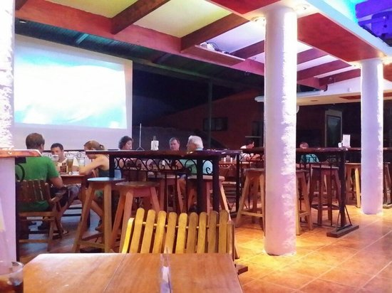 Bar Arriba: Bar seating w football game on screen